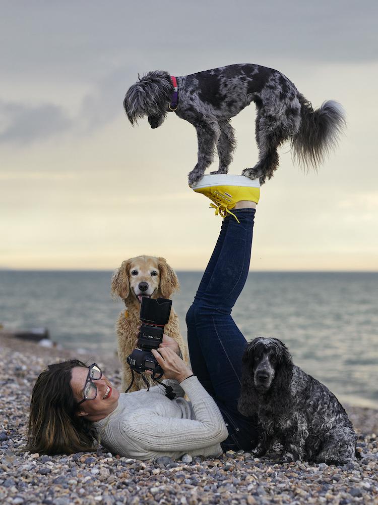 Photographer Liz Gregg and dogs performing balancing trick